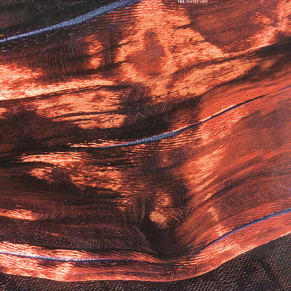 Copper fabric ikat dyed by hand on the warp. Materials; copper wire and polyamide 6.6